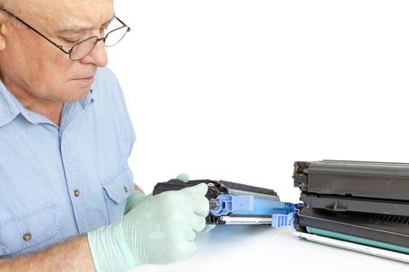printer cartridge: worker Laser printer on a workbench. Printer workshop