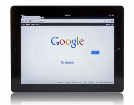 Galati, Romania - August 18, 2012: Apple Ipad 3 with the Google.com web site search engine displayed on lcd screen. Google.com is one of the most important search engine. Studio shot on white background. Stock Photo - 14986281