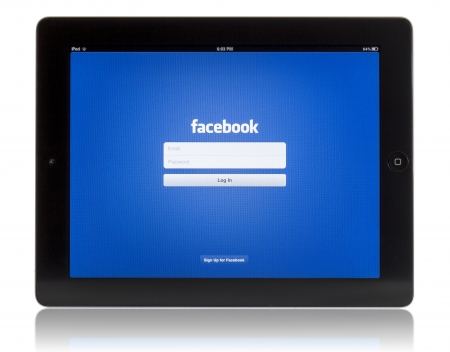 Galati, Romania - August 18, 2012: The New iPad displaying login screen of Facebook application. Studio shot on white background.
