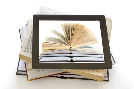 open Books over  tablet computer isolated on white, digital library concept,  photo