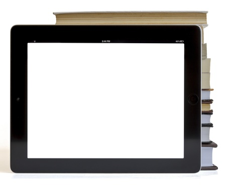 Books and tablet computer isolated on white, digital library concept