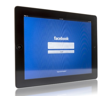 Galati, Romania - August 18, 2012: The New iPad 3 displaying login screen of Facebook application. Studio shot on white background.  Editorial