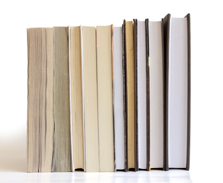 Books in a row isolated on white background photo