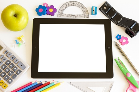 Ipad 3 white background with school accesories on white  Editorial