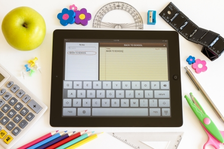 accesories: Ipad 3 with Notes application and school accesories on white