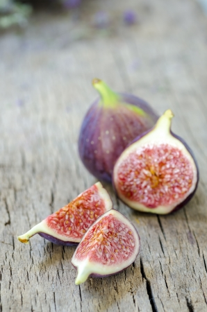 Ripe figs on wooden background photo