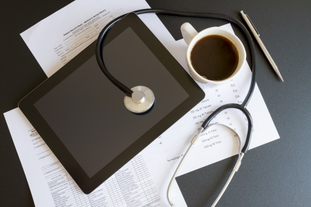 Digital tablet with stethoscope and paperwork Stock Photo - 16003530