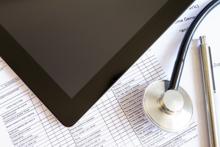 Digital tablet with stethoscope and paperwork Stock Photo - 16003519