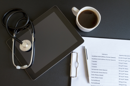 Digital tablet with stethoscope and paperwork Stock Photo - 16003523