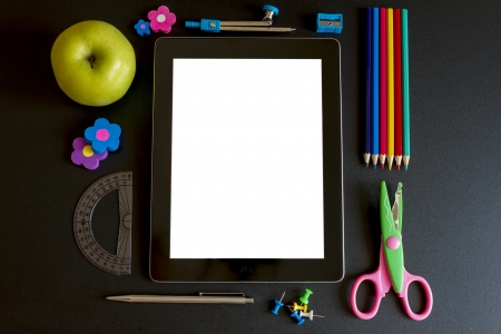 accesories: Tablet PC with school accesories on white background