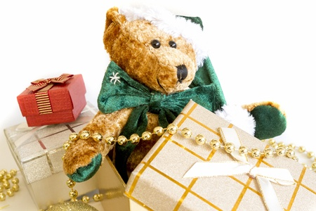 Christmas Gifts with teddy bear in gifts box isolated on white background. photo