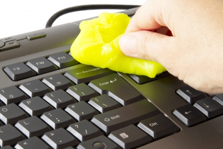 cleaning background: hand who clean the keyboard with a special sponge