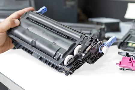 hand holding laser toner cartridge