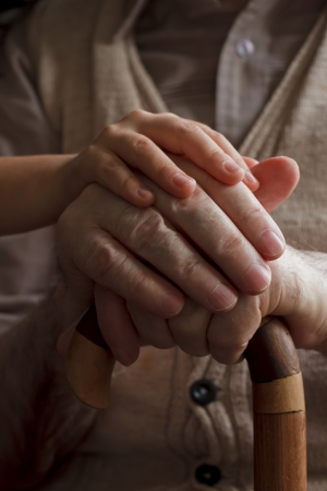 old hand: granddaughter hand holding his grandfather hands Stock Photo