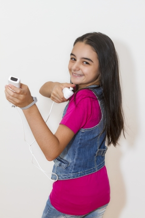 wii: Galati, Romania- September 01, 2012: Young teenage girl holding a Nintendo Wii controller (gamepad). The Nintendo Wii game console is produced by Nintendo.