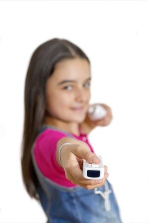 wii: Galati, Romania- September 01, 2012: Young teenage girl holding a Nintendo Wii controller (gamepad). The Nintendo Wii game console is produced by Nintendo.