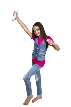 joy pad: Galati, Romania- September 01, 2012: Young teenage girl holding a Nintendo Wii controller (gamepad). The Nintendo Wii game console is produced by Nintendo.
