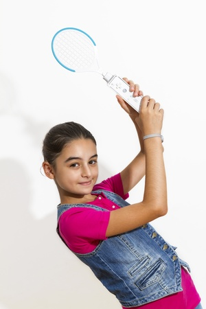 co action: Galati, Romania- September 01, 2012: Young teenage girl holding a Nintendo Wii controller (gamepad). The Nintendo Wii game console is produced by Nintendo.