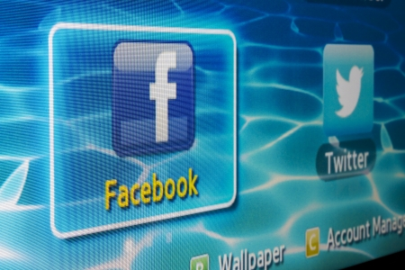 galati: Galati, Romania - Januarie 31, 2013: Close-up of Facebook for Samsung Internet TV makes it`s easy to stay connected and share information with friends from your TV.