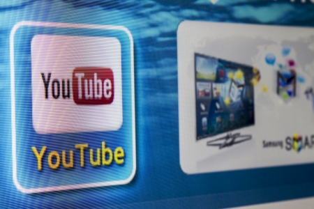 Galati, Romania - Januarie 16, 2013: YouTube app icon on a Tv screen. YouTube is the World's most acknowledged video sharing site, established in 2005. YouTube is owned by Google Stock Photo - 17838540