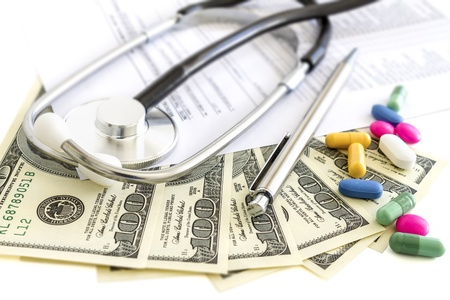Dollars, stethoscope, pills and medical form  Costs for the medical insurance  photo