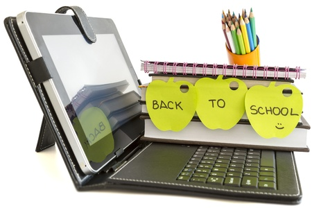 Back to school with digital tablet pc, books and pencils on white background photo