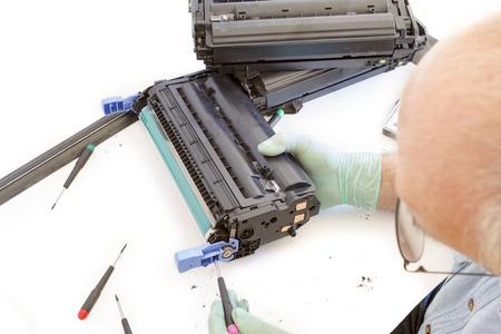 toner: worker Laser printer on a workbench  Printer workshop