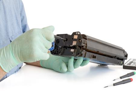printer cartridge: worker Laser printer on a workbench  Printer workshop
