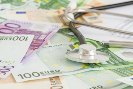 Euro with stethoscope on them  Costs for the medical insurance  photo
