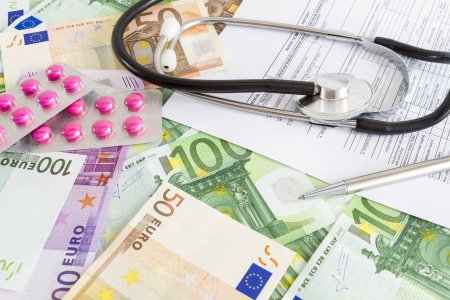 Costs for medical insurance Euro, stethoscope, pills and\ medical form