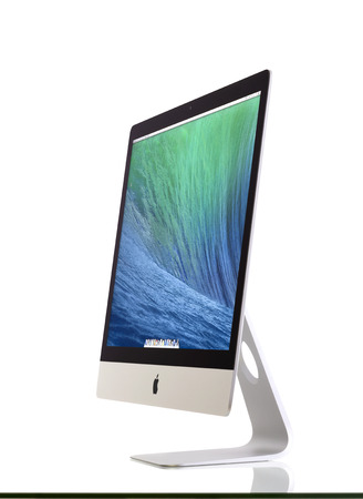 New iMac 27 With OS X Mavericks  It brings new apps to desktop  OSX is the operating system that powers every Mac  New Apple iMac 27 inch on glass against white background  Galati, Romania, February 26, 2014