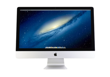 GALATI, ROMANIA, FEBRUARY 26, 2014: New iMac 27 inch Ultrathin design. The desktop. In its most advanced form ever. OSX is the operating system that powers every Mac. New Apple iMac 27 inch on white background. Galati, Romania, February 26, 2014