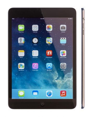galati: GALATI, ROMANIA, JANUARY 23, 2014: - iPad mini is powered by the new A7 chip with 64-bit architecture. A7 delivers killer performance — up to four times faster CPU and up to eight times faster graphics performance than the previous generation — withou