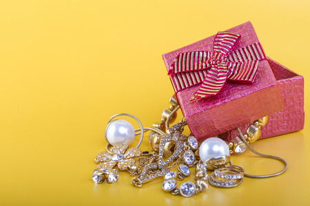 Jewlery gift box on yellow background photo