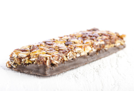 cereal bar: Chocolate Muesli Bars on white wooden background Stock Photo
