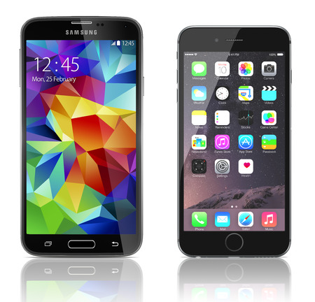 samsung galaxy: Comparison of Samsung Galaxy S5 and Apple iPhone 6 side by side. Samsung Galaxy S5 is the newest smart phone from Samsung and Apple Silver iPhone 6 Plus showing the home screen with iOS 8.
