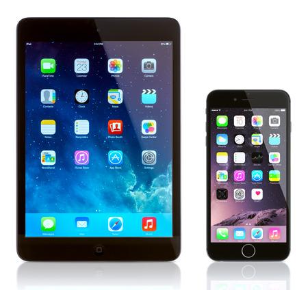 Galati, Romania - September 23, 2014: iPad Mini and iPhone 6 on white. Apple iOS 8 applications on the home screen of the iPhone 6 and iPad. Apple released the iPhone 6 and iPhone 6 Plus on September 9, 2014.