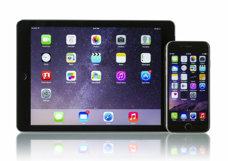 Apple Space Gray iPhone 6 and iPad Air 2 Wi-Fi + Cellular with iOS 8. Apple released the iPhone 6 and iPhone 6 Plus on September 9, 2014. Apple released iPad Air 2 on October 16, 2014.