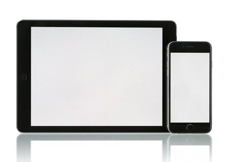Apple Space Gray iPhone 6 and iPad Air 2 Wi-Fi + Cellular with blank screen. Apple released the iPhone 6 and iPhone 6 Plus on September 9, 2014. Apple released iPad Air 2 on October 16, 2014.
