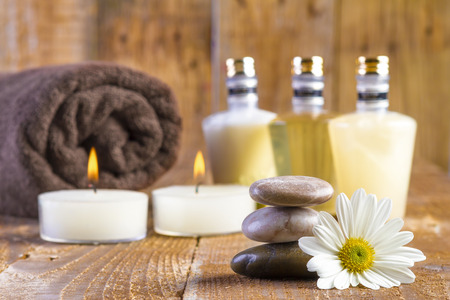 zen basalt stones and spa oil with candles on the wood photo
