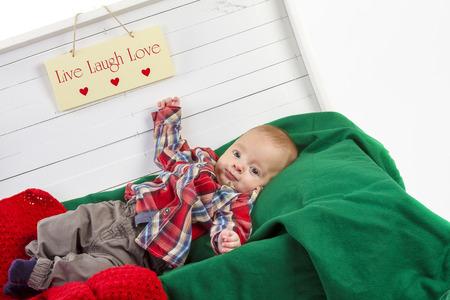 christmas baby boy  in white gift box photo