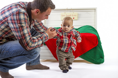 Baby boy with his father on white background photo