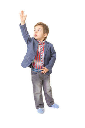 hand lifted: little boy with jacket and shirt with his hand lifted up on white background Stock Photo