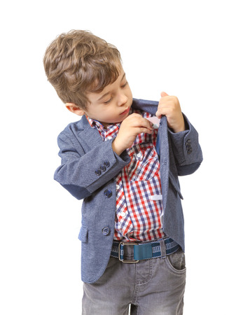 hands lifted up: little boy puts money in his pocket on white background