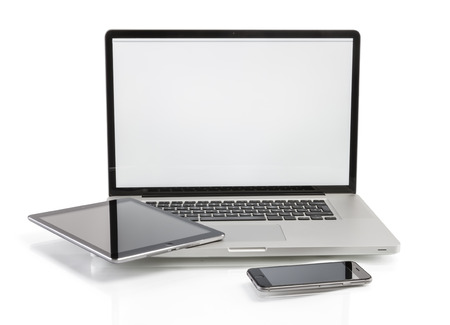 modern computer devices - laptop, tablet and phone with copy space on screen Standard-Bild