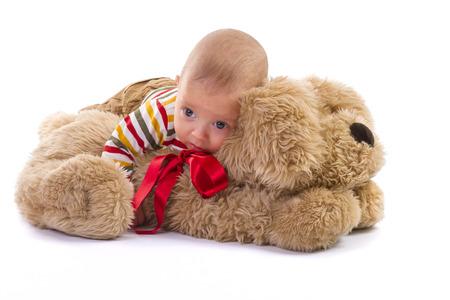 plush: baby boy over plush dog on white background Stock Photo