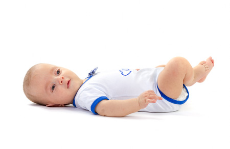 lay down: baby boy lying on white background