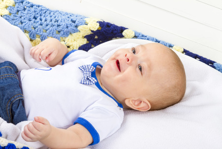 new born baby boy: baby boy laughing on blanket
