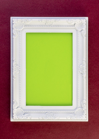 dark red: White Frame on dark red with green for your copy Stock Photo