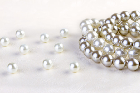 string of pearls: Silver and White pearls necklace on white paper background